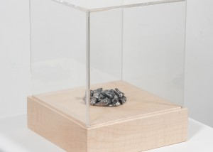 "Image of ""Thirty Pieces"" sculpture depicting a small pile of thirty human teeth cast in lead"