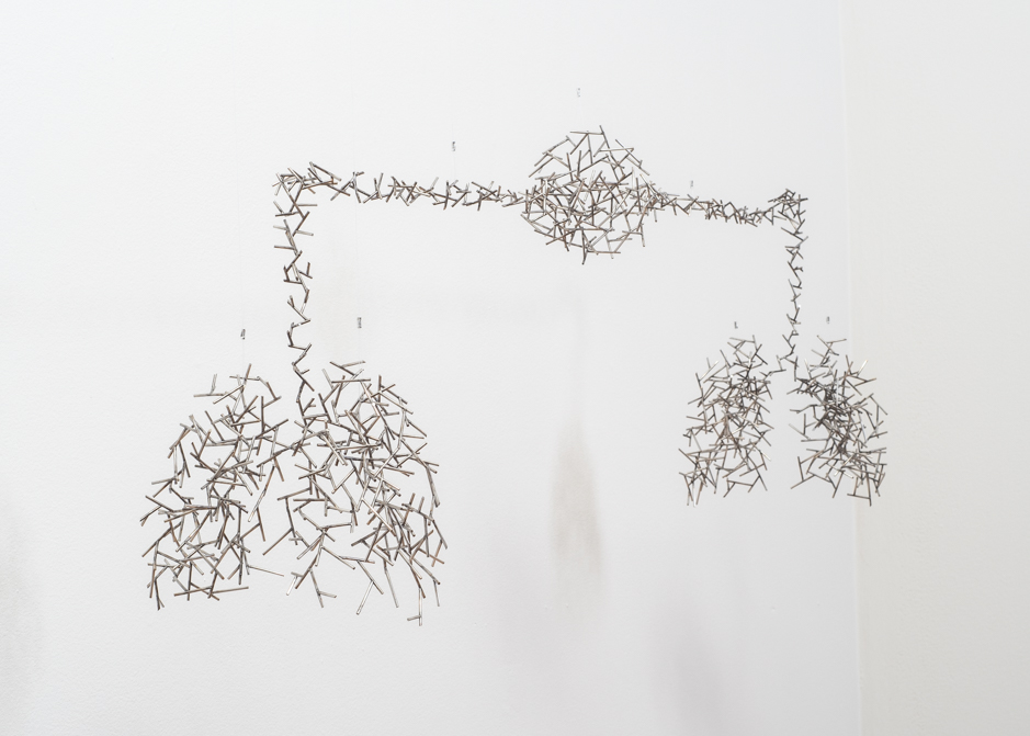 "Image of ""Exchange III"" sculpture created from welded stainless steel"