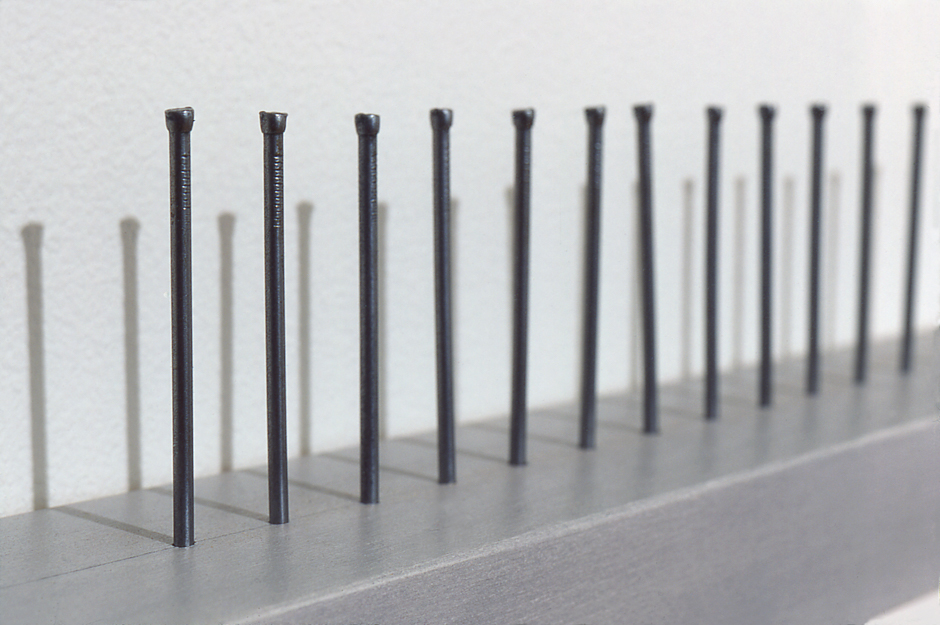 """Detail image of wall hung """"Impotent II"""" sculpture created using nails hammered into wood"""