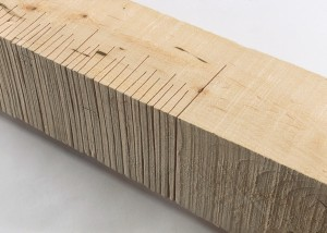 "Detail image of floor standing ""Measure XII"" sculpture created from handsawn wood"
