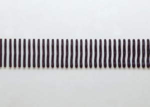 """Image of wall mounted """"Replication I"""" sculpture created from wood bandsawn and burnished with graphite"""