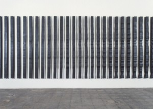"Image of wall mounted ""Replication II"" sculpture created from wood bandsawn and burnished with graphite"
