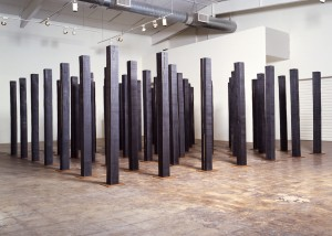 "Image of floor standing ""Replication Field"" sculpture created from bandsawn wood and burnished with graphite"