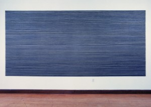 "Image of wall mounted ""Straight IV"" sculpture created using bandsawn wood and graphite"